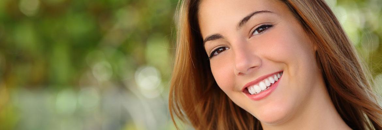 Smiling woman at park