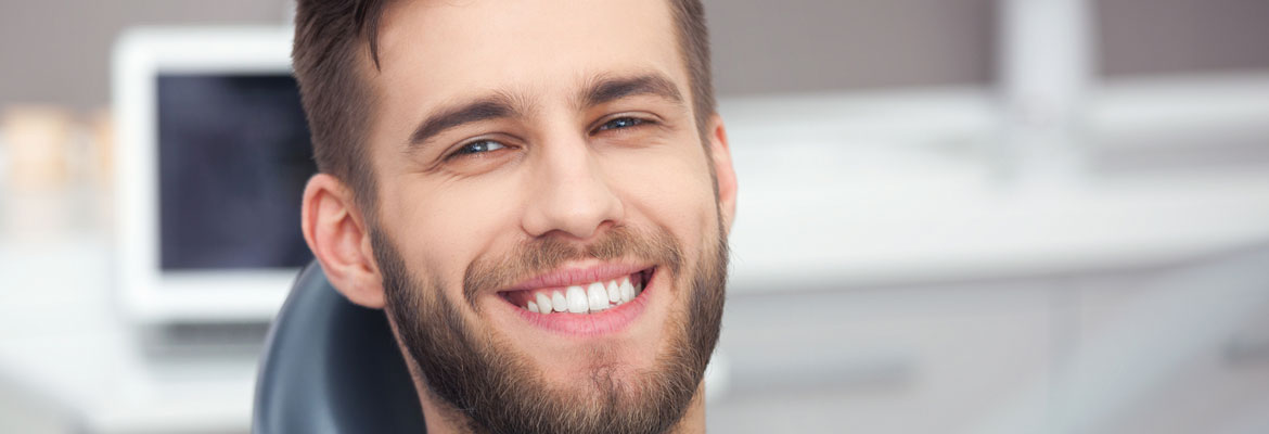 Smiling man at dental office